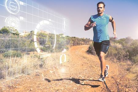 Photo pour Athletic man jogging on country trail against fitness interface - image libre de droit