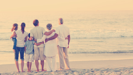 Photo pour Beautiful family at the beach - image libre de droit
