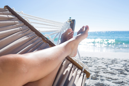 Photo for Woman relaxing in the hammock at the beach - Royalty Free Image