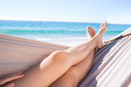 Photo pour Woman relaxing in the hammock at the beach - image libre de droit