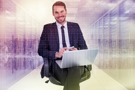 Happy businessman with laptop using smartphone against digitally generated server room with towers