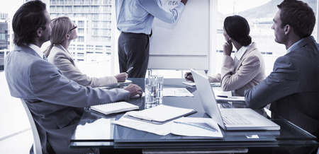 Foto de Young business people in board room meeting at the office - Imagen libre de derechos