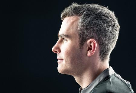 Foto de Profile view of a rugby player on a black background - Imagen libre de derechos