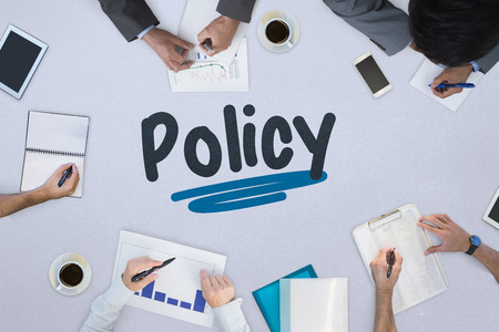 Photo pour The word policy against business meeting - image libre de droit