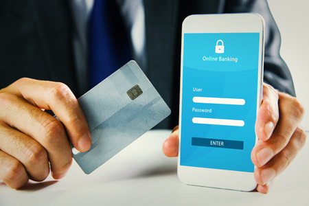 Businessman using smartphone against online banking