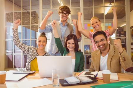 Photo pour Group of young colleagues using laptop at office - image libre de droit