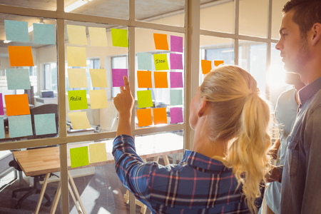 Foto de Young creative business people at office - Imagen libre de derechos