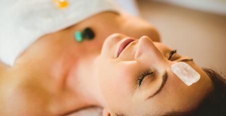 Foto de Young woman at crystal healing session in therapy room - Imagen libre de derechos