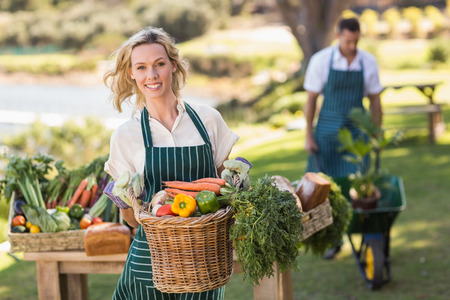 Photo for Portrait of a farmer woman holding a vegetable basket - Royalty Free Image