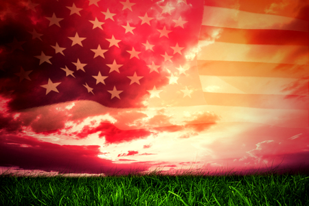 Photo for United states of america flag against green grass under red and purple sky - Royalty Free Image