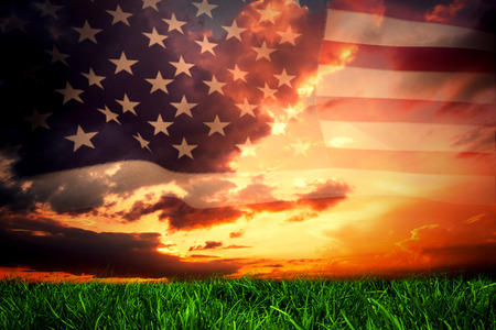 Photo for United states of america flag against green grass under dark blue and orange sky - Royalty Free Image