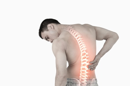 Foto de Digital composite of Highlighted spine of man with back pain - Imagen libre de derechos