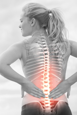 Photo for Digital composite of Highlighted spine of woman with back pain - Royalty Free Image