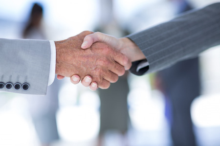 Photo for Businessman shaking hands with a co worker in an office - Royalty Free Image