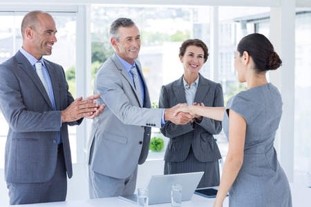 Photo for Interview panel shaking hands with applicant in the office - Royalty Free Image