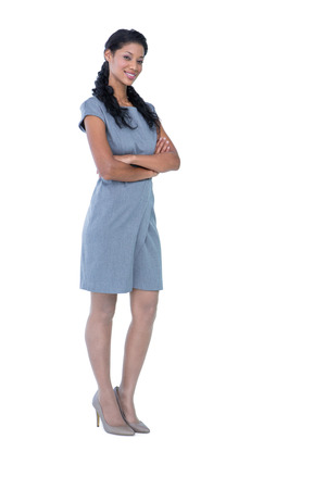 Photo for Happy pretty businesswoman looking at camera with arms crossed on white background - Royalty Free Image