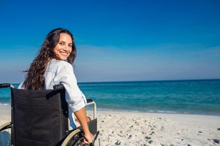 Foto de Disabled woman looking at camera on a sunny day - Imagen libre de derechos
