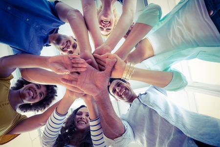 Foto de Creative team putting their hands together in circle - Imagen libre de derechos