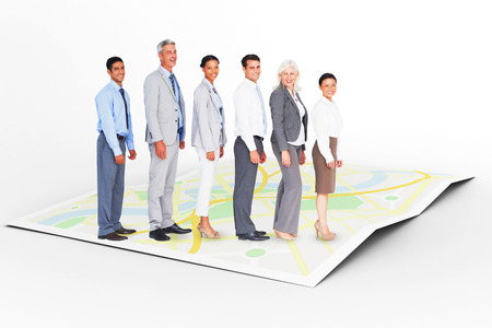 Business people looking at camera  against city map