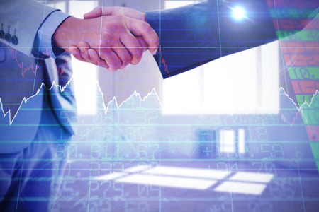 Business handshake against stocks and shares
