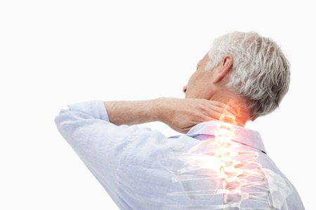 Foto de Digital composite of Highlighted spine pain of man - Imagen libre de derechos