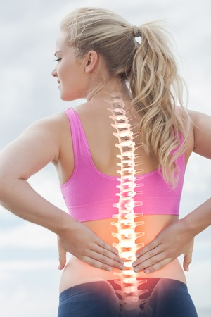 Photo pour Digital composite of Highlighted spine of woman with back pain - image libre de droit