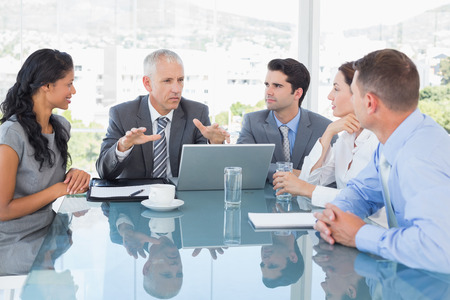 Foto de Business team working together on laptop in the office - Imagen libre de derechos