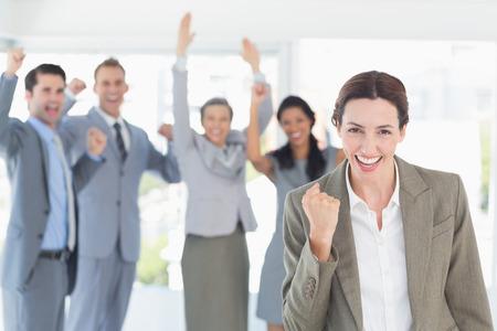 Photo pour Business team celebrating a good job in the office - image libre de droit