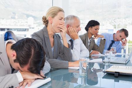 Foto de Tired business team at conference in the office - Imagen libre de derechos