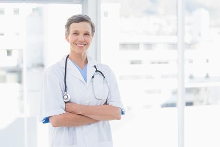 Photo pour Smiling female doctor in medical office - image libre de droit