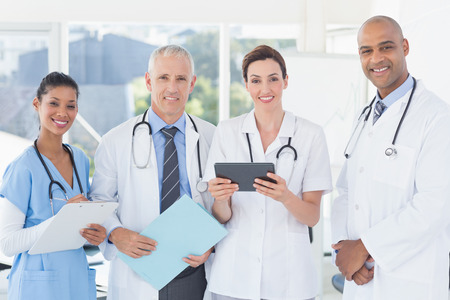 Photo for Team of doctors working together on patients file in medical office - Royalty Free Image