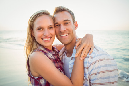 Photo for happy couple smiling at the beach - Royalty Free Image