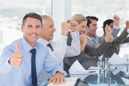 Photo for Business team celebrating a good job in the office - Royalty Free Image
