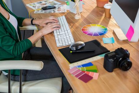 Foto de Designer typing on keyboard in the office - Imagen libre de derechos