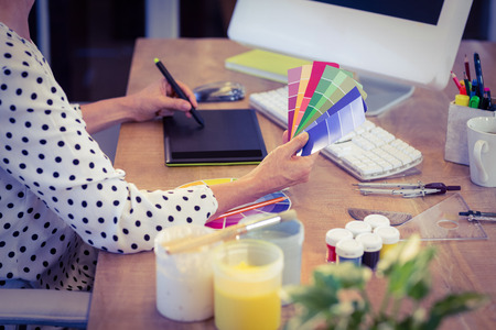Foto de Interior designer working at desk in creative office - Imagen libre de derechos