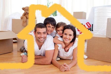 Photo for Happy family after buying new house against house outline - Royalty Free Image