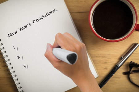 Photo pour Composite image of new years resolutions against overhead of notepad and pen and coffee - image libre de droit