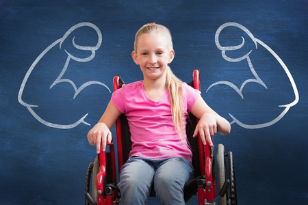 Photo pour Cute disabled pupil smiling at camera in hall  against blue chalkboard - image libre de droit