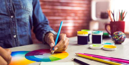 Photo for Graphic designer drawing on colour chart at workplace - Royalty Free Image