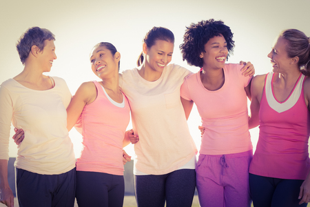 Photo for Laughing women wearing pink for breast cancer in parkland - Royalty Free Image