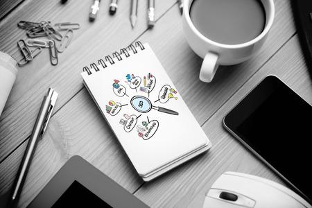 Foto de seo doodle against notepad on desk - Imagen libre de derechos
