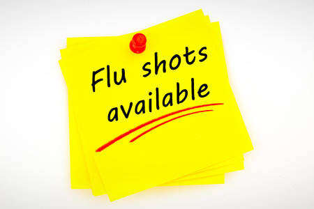 Photo for flu shots available against sticky note with red pushpin - Royalty Free Image