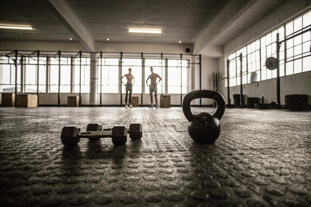 Photo for Two fit people on the background in crossfit gym - Royalty Free Image