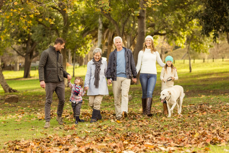 Foto per Smiling extended family walking together on an autumns day - Immagine Royalty Free