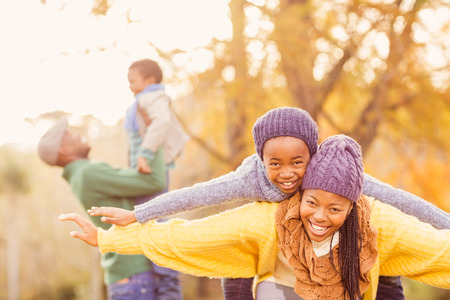 Photo for View of a happy young family on an autumns day - Royalty Free Image