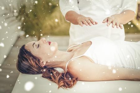 Foto de Snow against calm woman receiving reiki treatment - Imagen libre de derechos