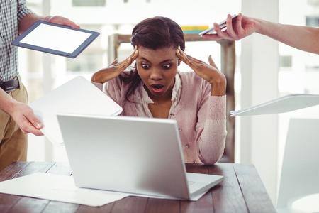 Foto de Businesswoman stressed out at work in casual office - Imagen libre de derechos