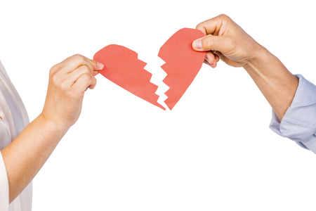 Couple holding broken heart on white background