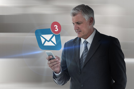 Businessman using his smartphone against abstract white design