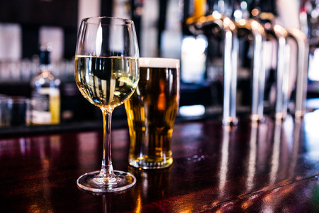 Photo for Close up of a glass of wine and a beer in a bar - Royalty Free Image